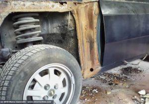 Ruggine e stucco su Lancia Beta Coupé prima restauro